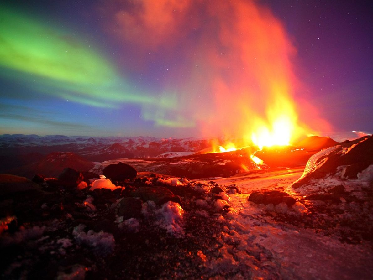 A volcanic eruption and the eruption of light from charged particles in  the atmosphere — ...
