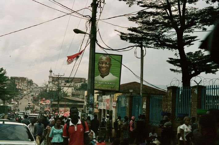 A sign displays the face of Dr Denis Mukwege above the streets of Bukavu. Founder of ...