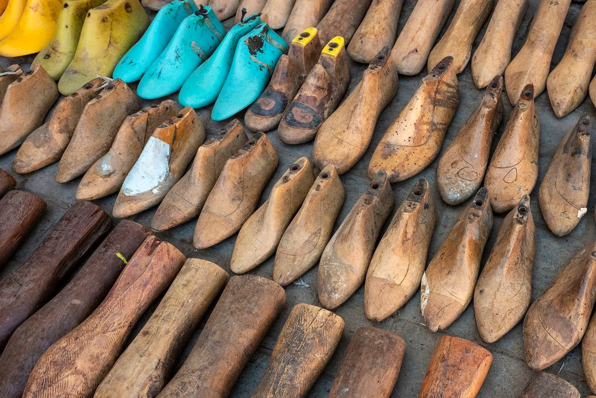 Second-hand wooden moulds for sale in a street market in the leather artisans' quarter of the ...