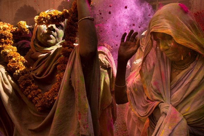 Widows enjoy Holi at the Gopinath Temple in Vrindavan in the Indian state of Uttar Pradesh. ...