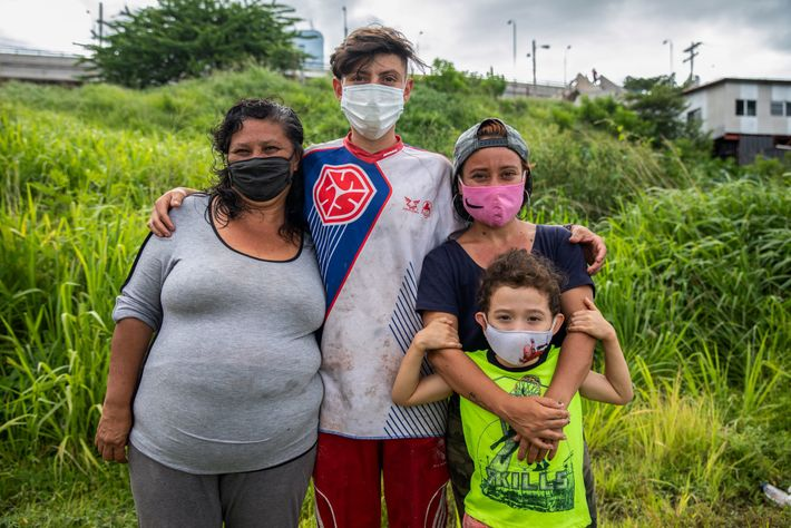 Telma, left, stands with her son, David, daughter, Lilian, and grandson, Gabriel, on the outskirts of ...