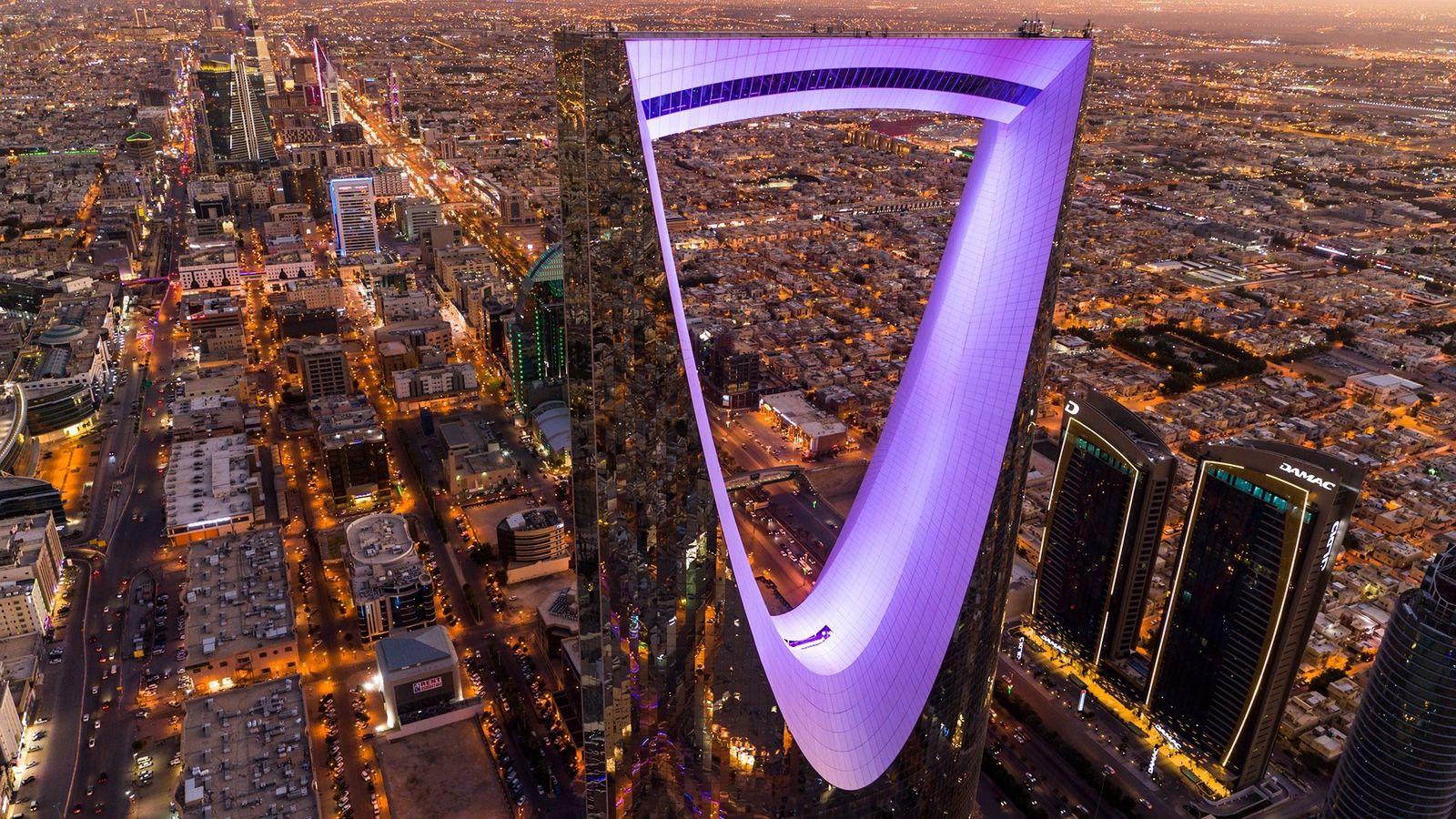 The 992-feet-high Kingdom Centre reflects its city: Riyadh, capital of Saudi Arabia, a kingdom built on ...