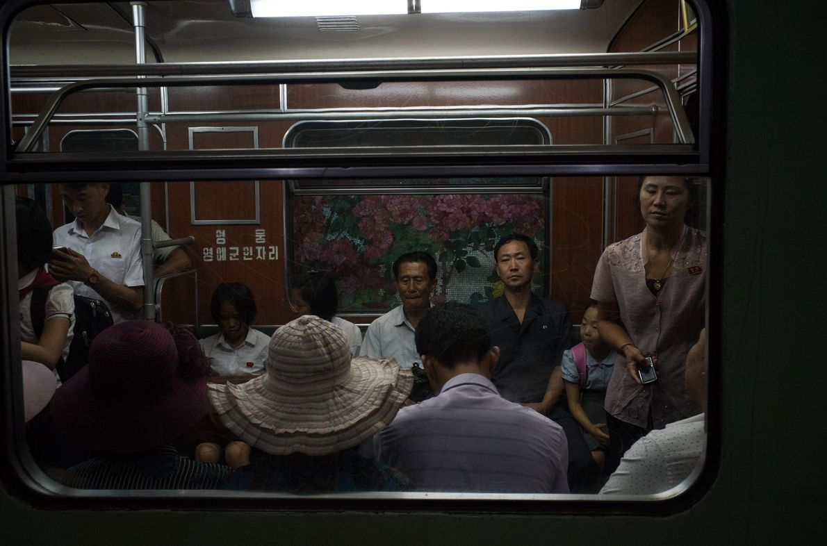 Commuters ride the subway in Pyongyang.