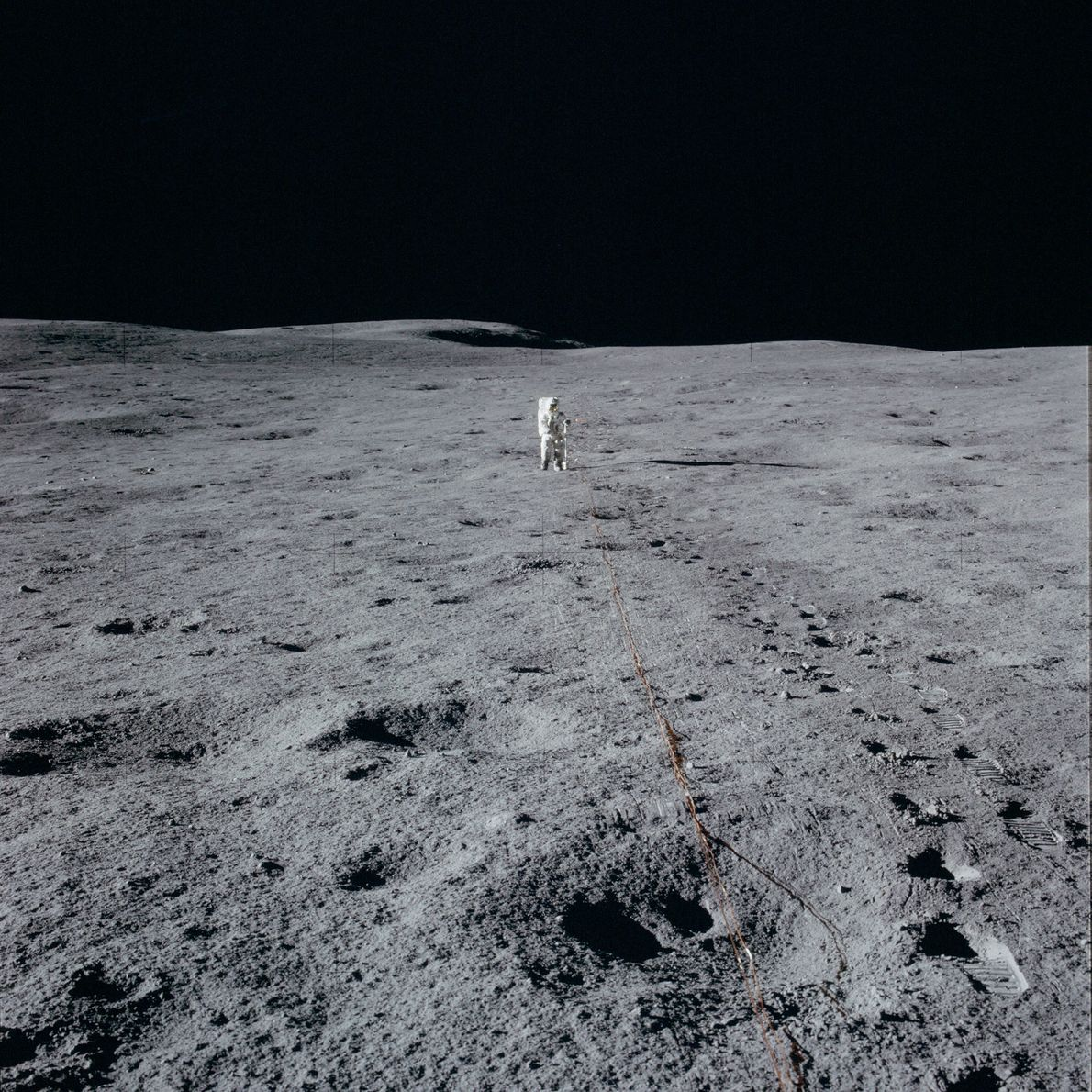 Alan Shepard mans a TV camera during Apollo 14. He was the first astronaut to hit ...