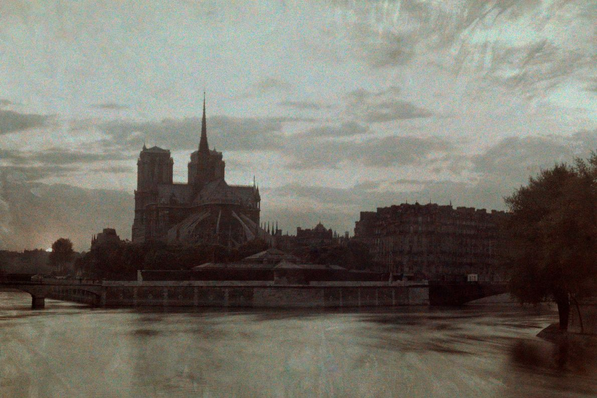Sunset darkens the Notre Dame in this photograph from 1923.
