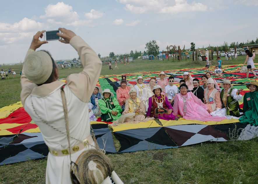 """Festival participants take a group photo at the Ysyakh festival just outside of Yakutsk. """"Ysyakh is ..."""