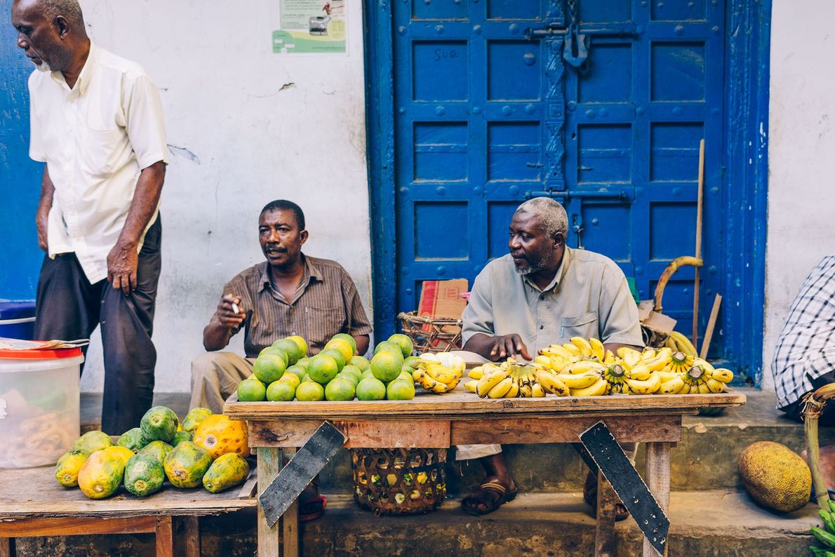 Fruit sellers — with guava, bananas and oranges — add a burst of green, yellow and ...