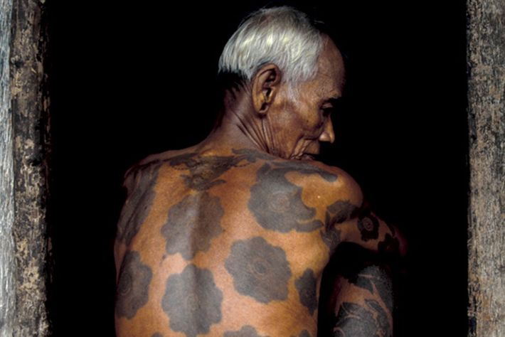 The tattooed back of a man.