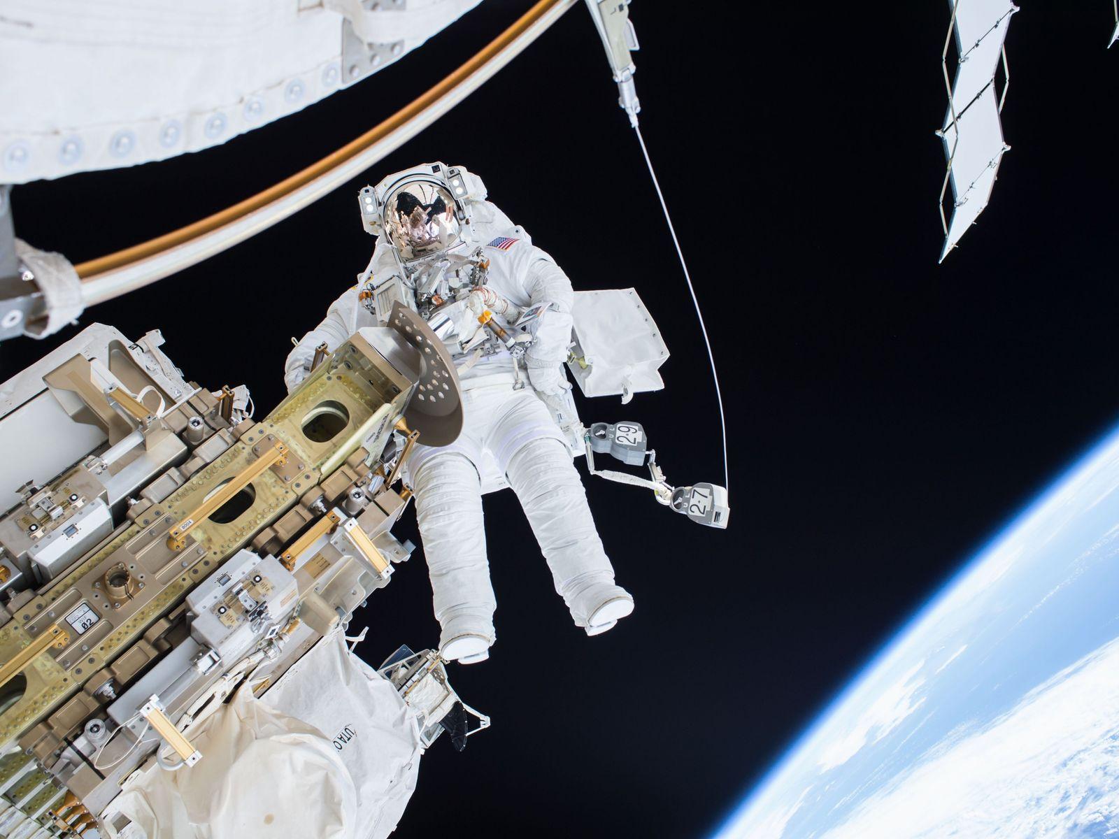 NASA astronaut Tim Kopra floats alongside the International Space Station during a spacewalk.