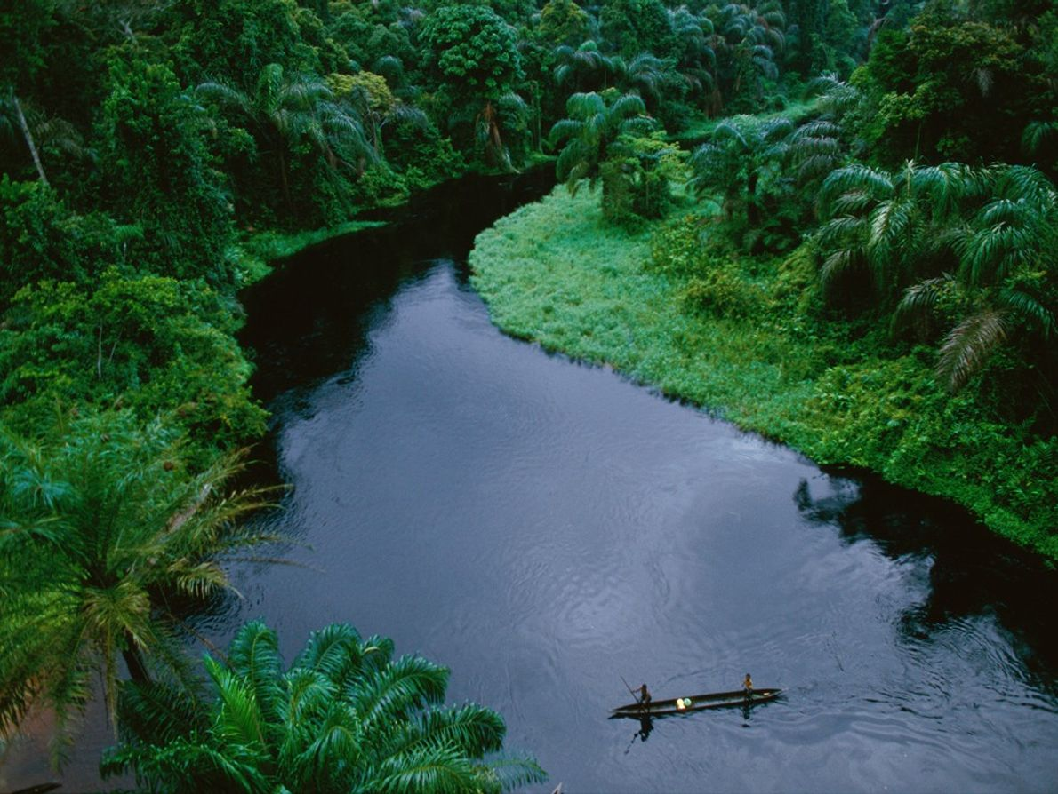 Canoes are vital for transportation on the rain forest rivers of the  Republic of the ...
