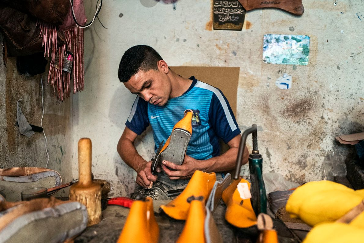 A highly skilled artisan in his workshop making traditional Moroccan shoes. Transforming the hides into finished ...