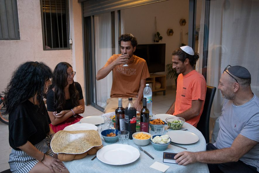 Uriel (right) and Isabelle (left) Herzberg celebrate their first Shabbat dinner as citizens of Israel with ...
