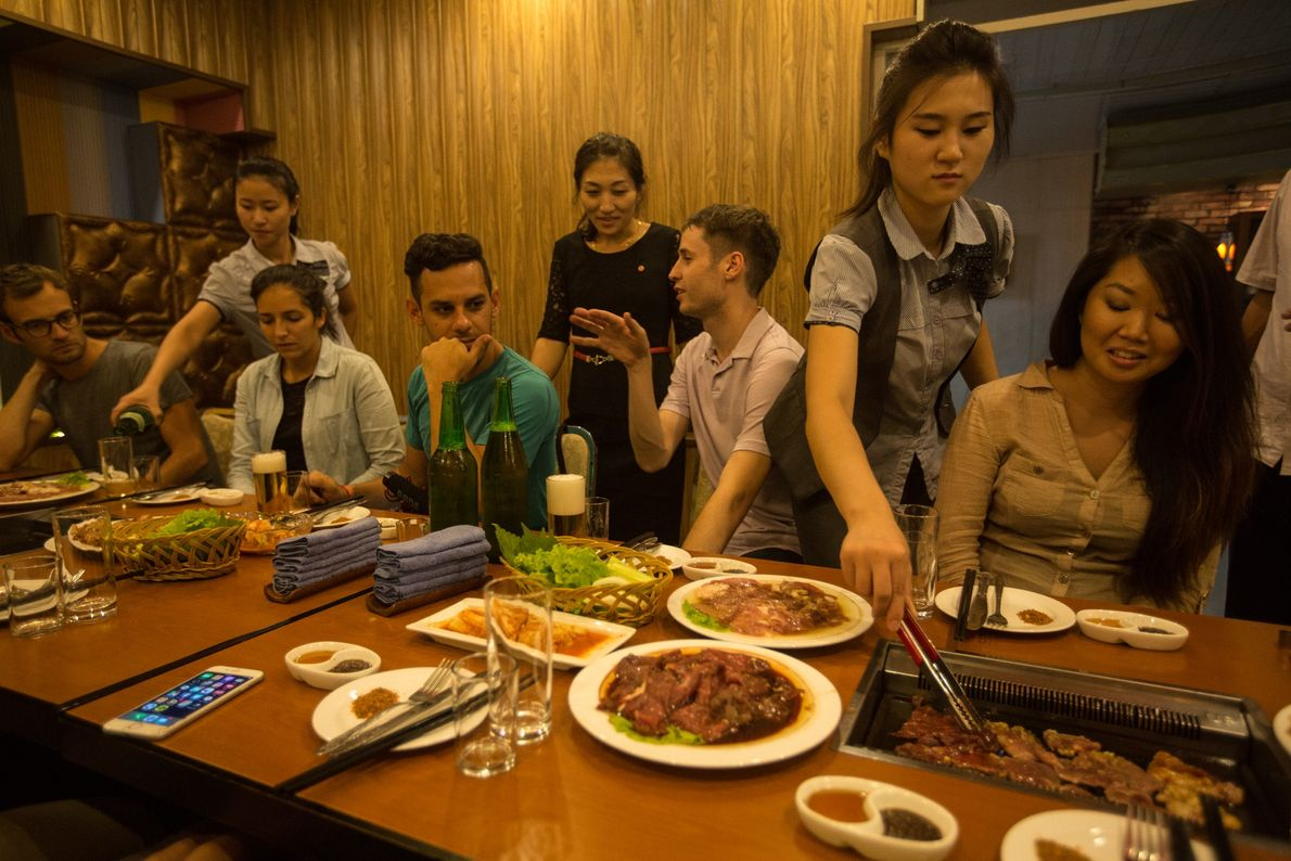 U.S. and French tourists have dinner at a restaurant in Pyongyang.