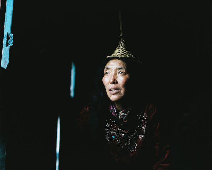 Fifty-three-year-old Lham looks out the window of her home in Laya.