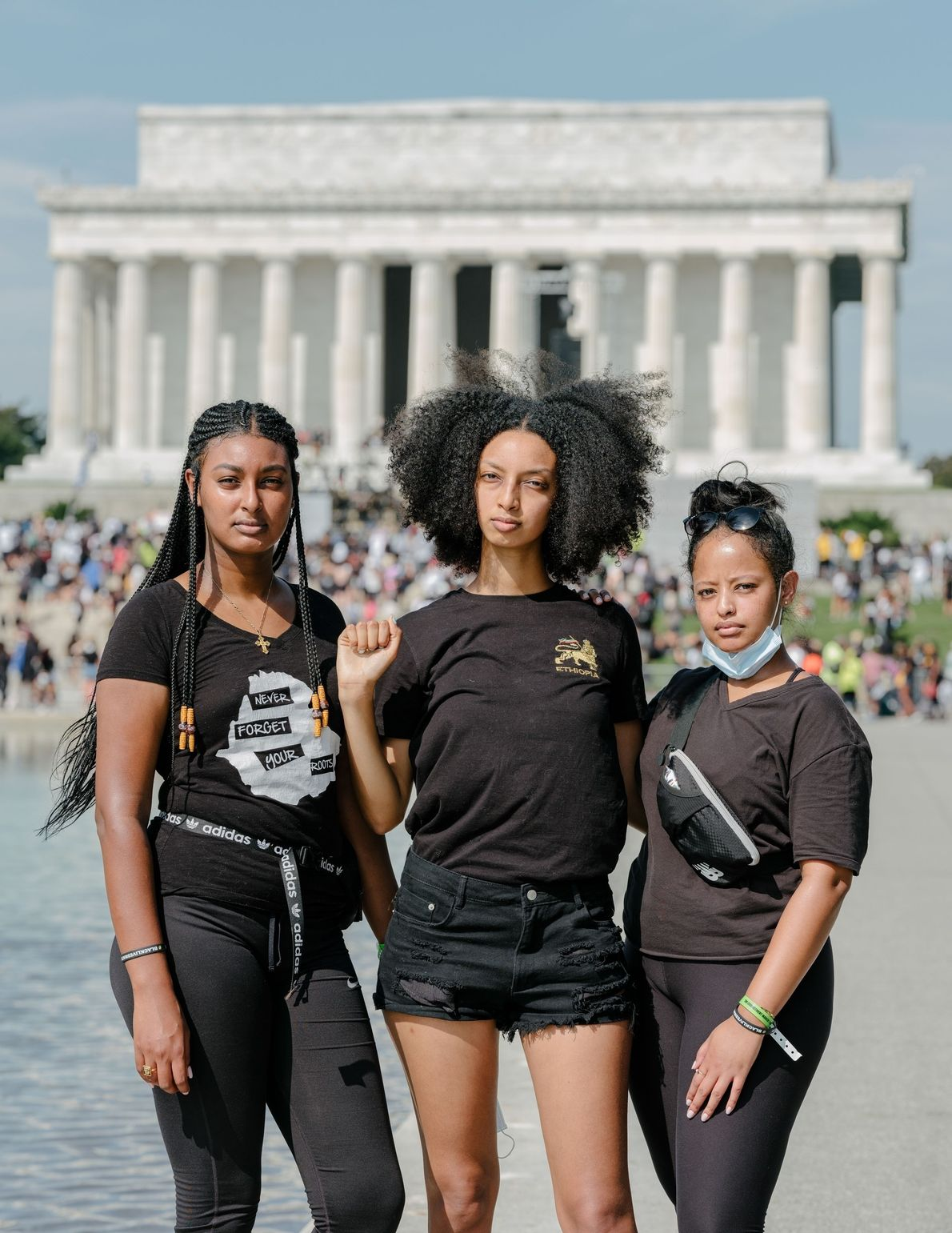 Alem Bekeie, Herani Bekele, and Bayza Anteneh stand in front of the Lincoln Memorial during the ...