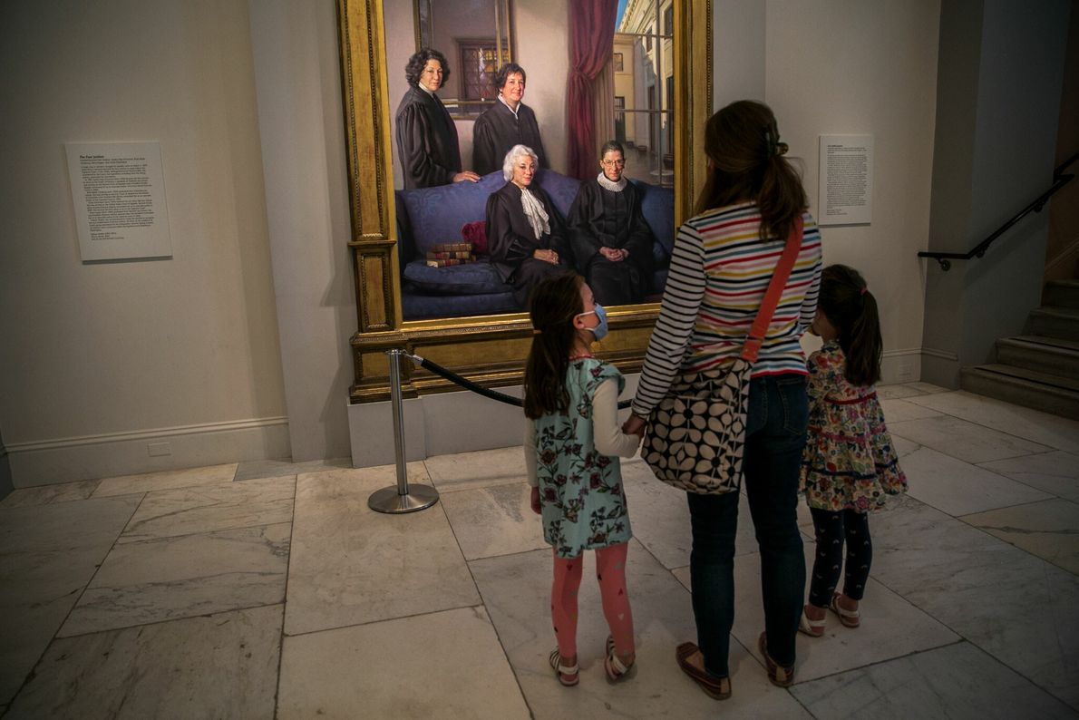 Lauren Stocker and her daughters pause in front of the portrait of the four women Supreme ...