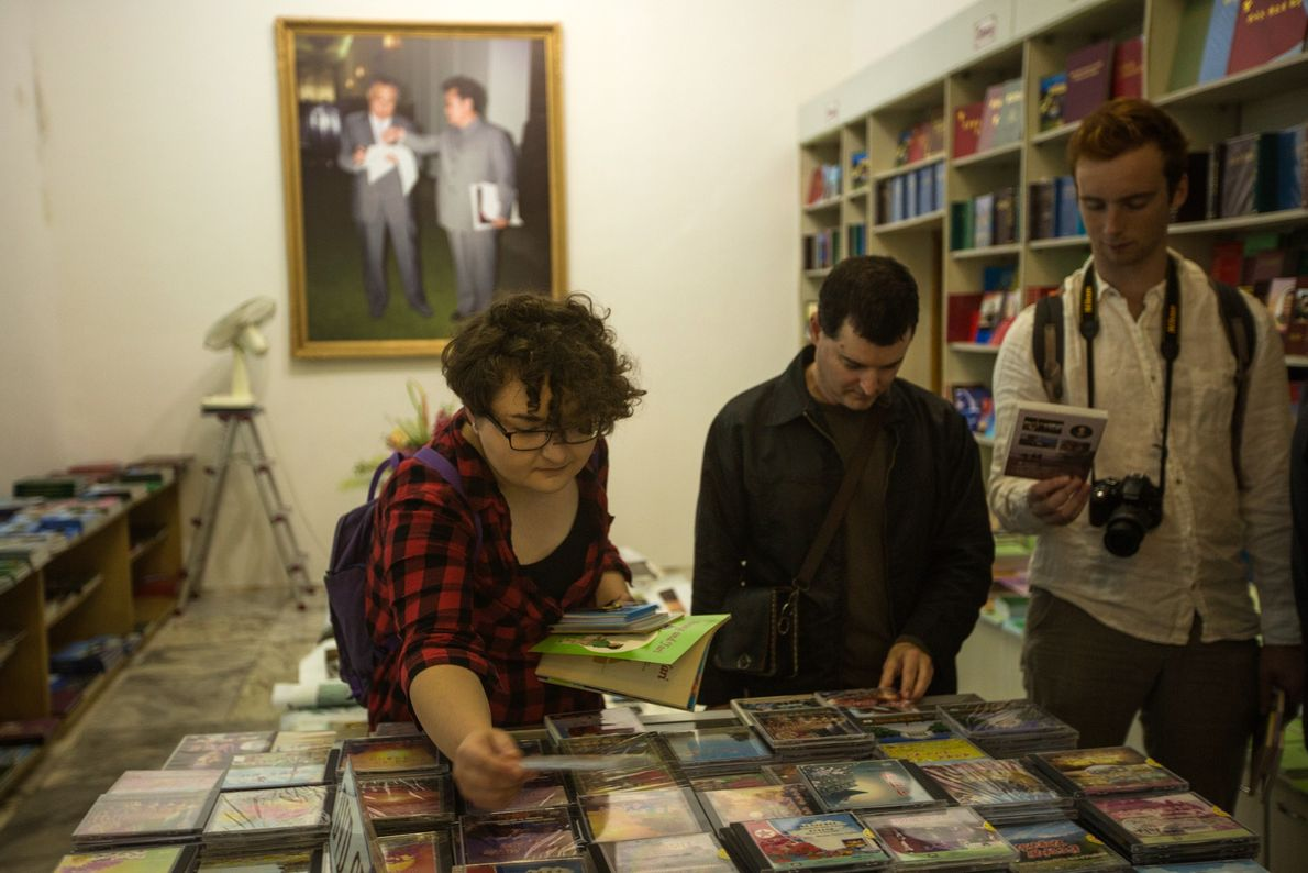 Tourists at a foreign language bookshop in Pyongyang shop for DVDs of North Korean movies.