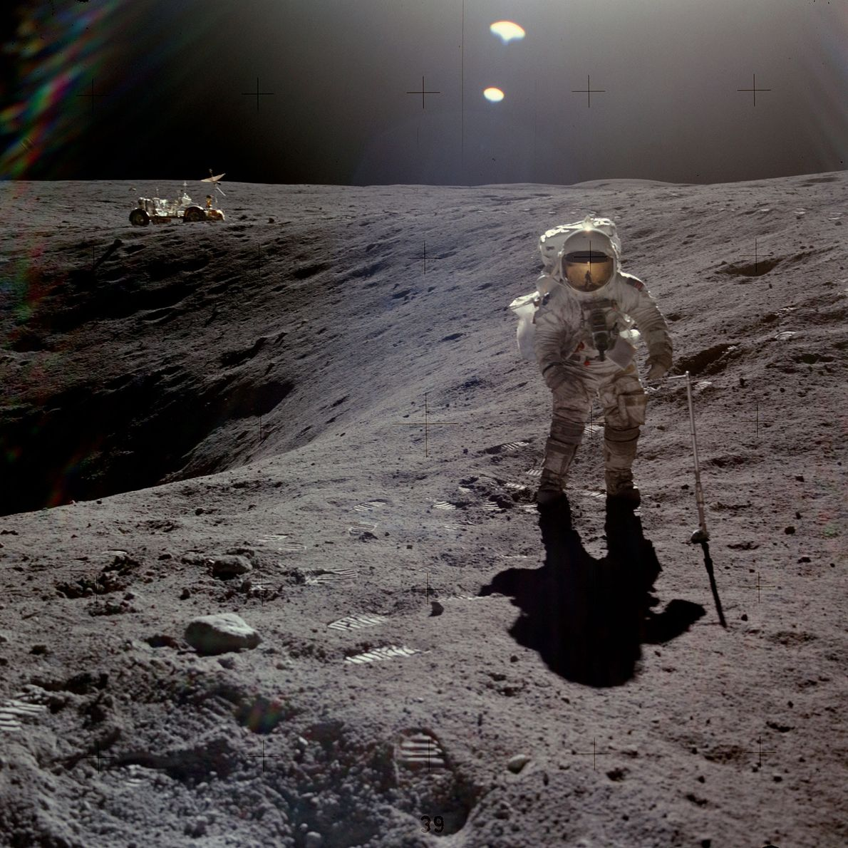 Astronaut Charles Duke collecting samples during the Apollo 16 mission. He and John Young were the ...