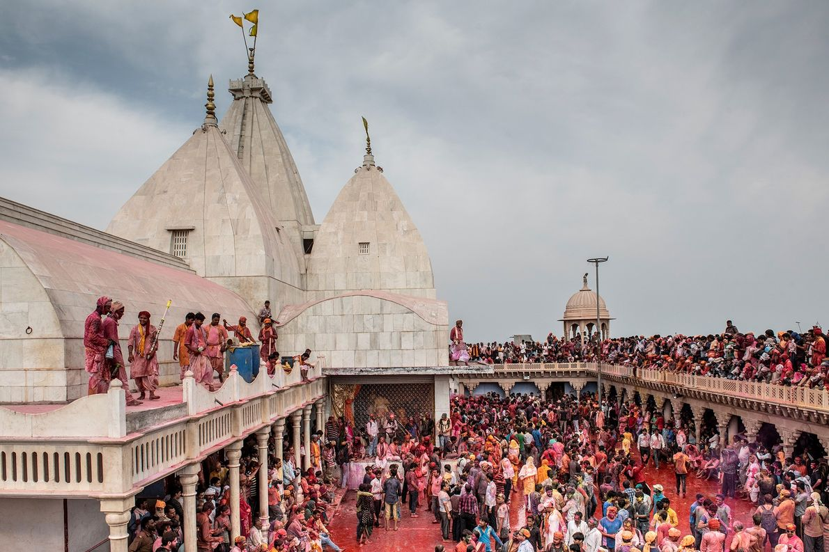 Most photographers position themselves on the roof of the Sriji Temple, in Nandgaon, while others get ...