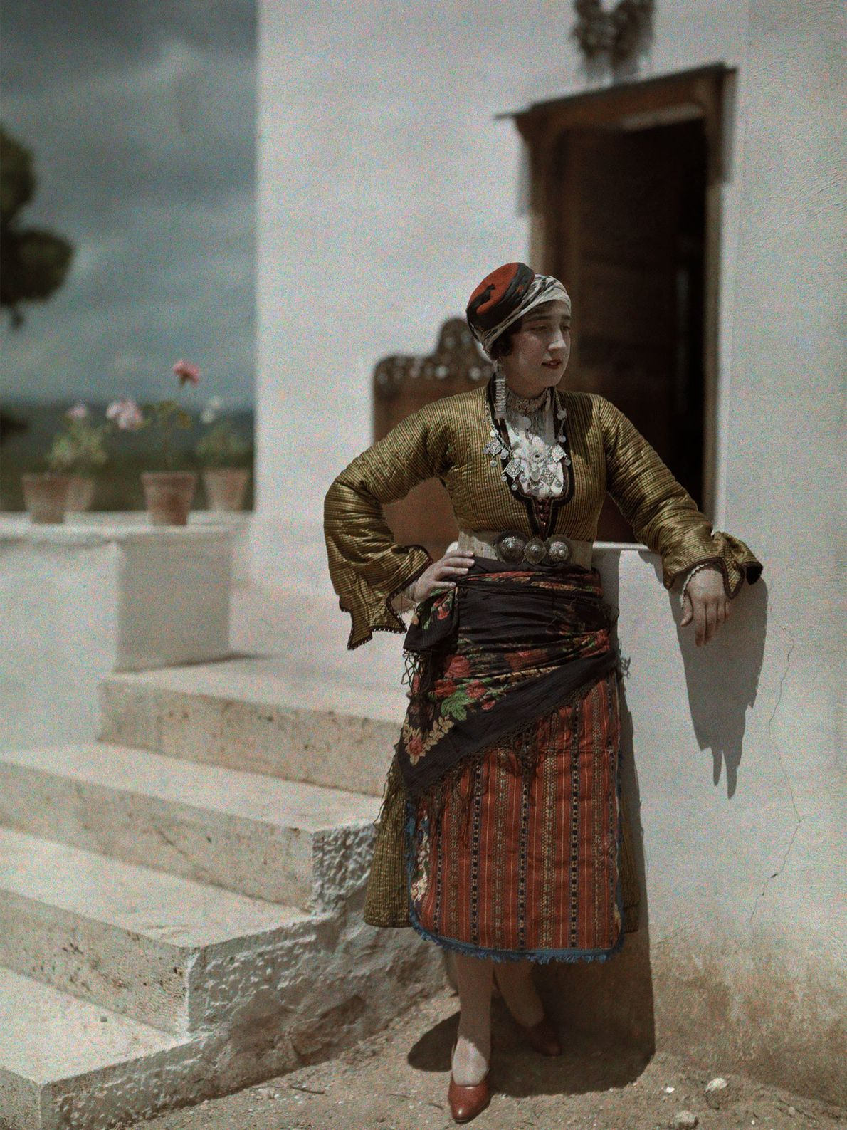 A woman at the Delphic Festival near Kephissia, Greece, poses in a hat and clothing typical ...