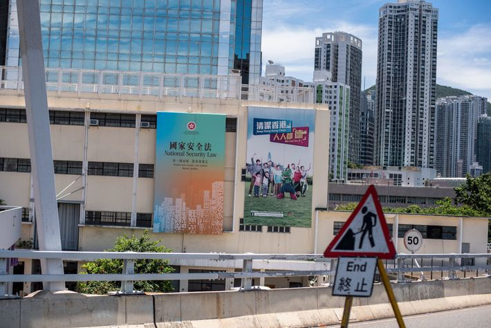 A billboard on the side of a government building promotes the new national security law. When ...