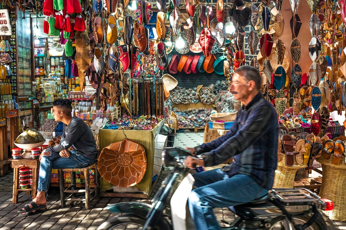 Daily life in the souk of Marrakech. A merchant awaits custom outside his shop, contemplating life ...