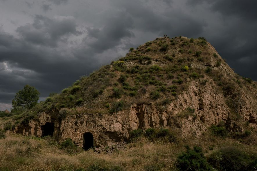 The sky darkens over the doorway of a cave home in Benalúa, a village in the ...