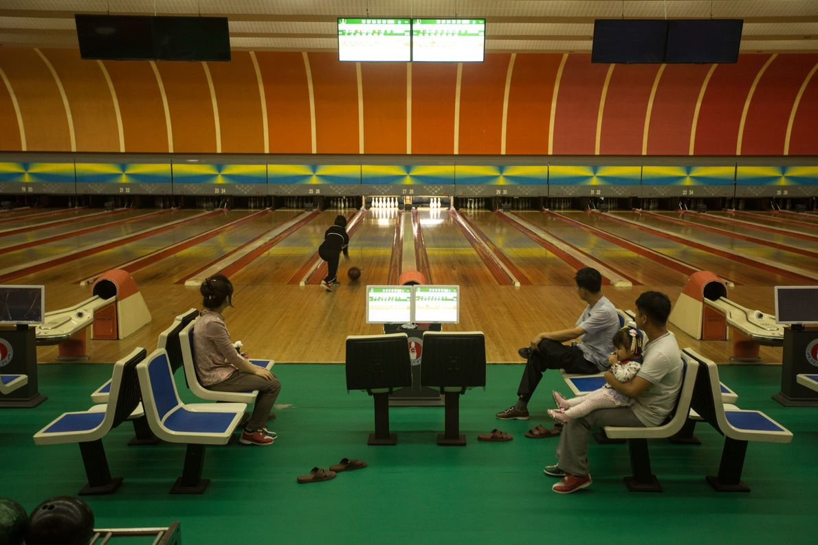 North Koreans bowling at an alley in Pyongyang.