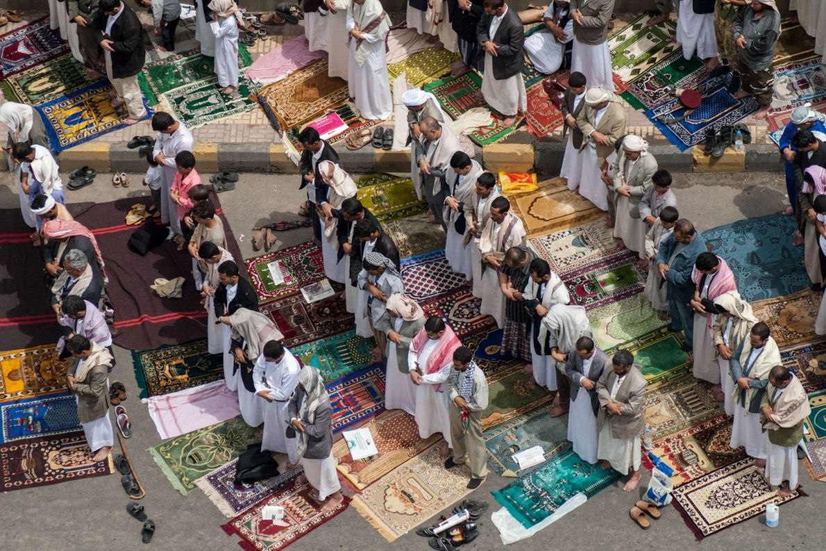 Hundreds of fathers, brothers, and sons gather for Friday prayers in the the Yemeni capital of ...