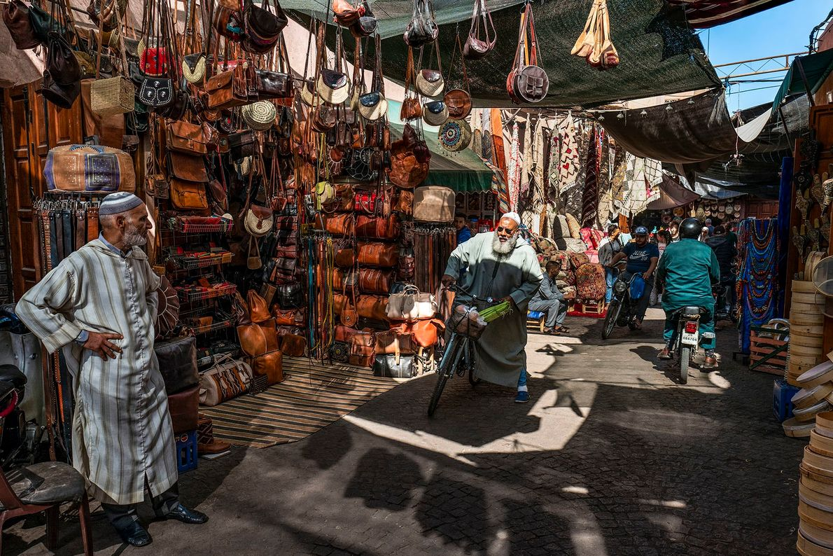 One of the main lanes of the souks. The bustling activity, the many products on sale, ...