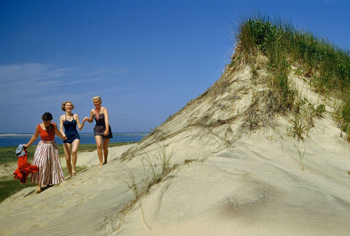 Women laugh among the sand dunes in Montauk.