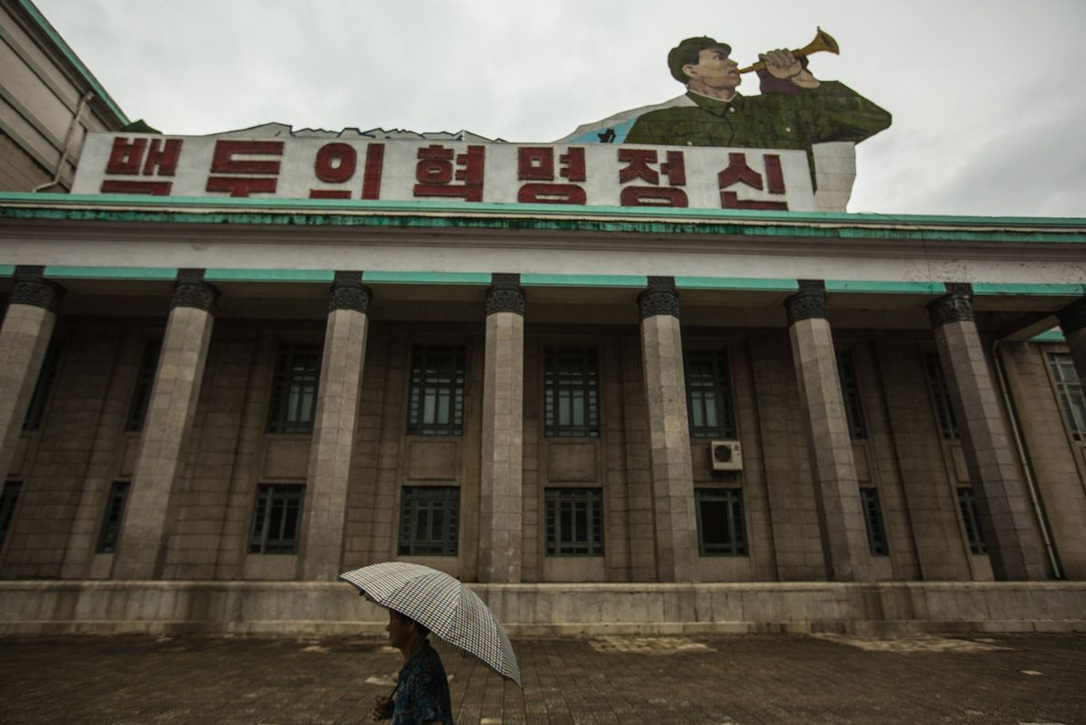 A man passing through Kim Il Sung Square in Pyongyang.