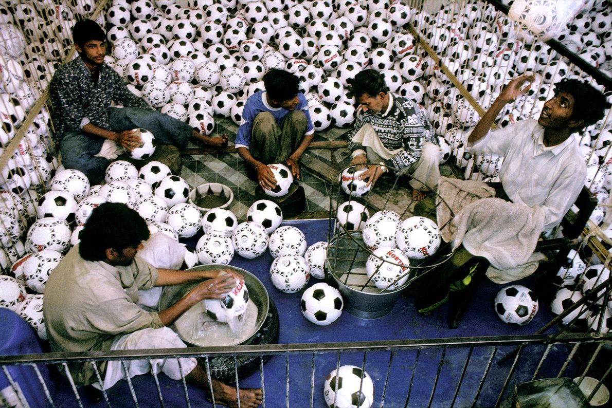 Young workers wash balls at a football factory in Sialkot, Pakistan, in 1998.