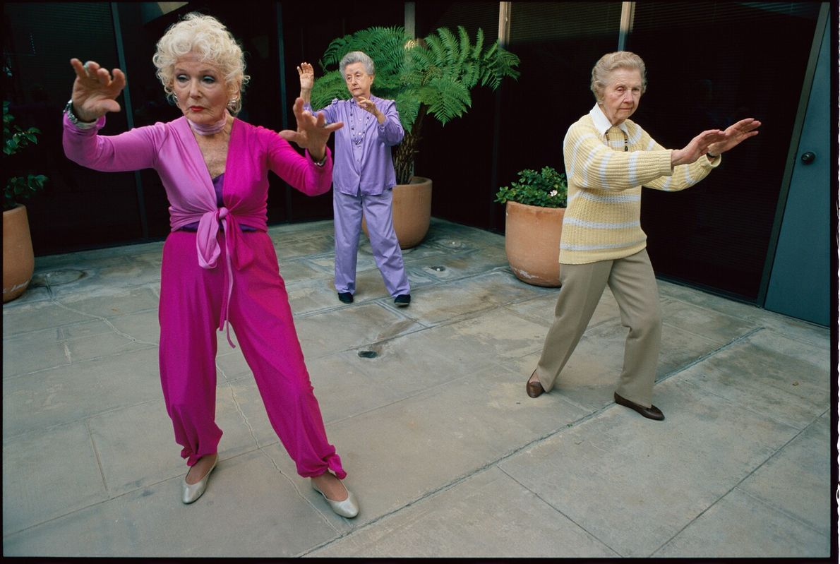 Picture of three elderly women performing tai chi in Los Angeles