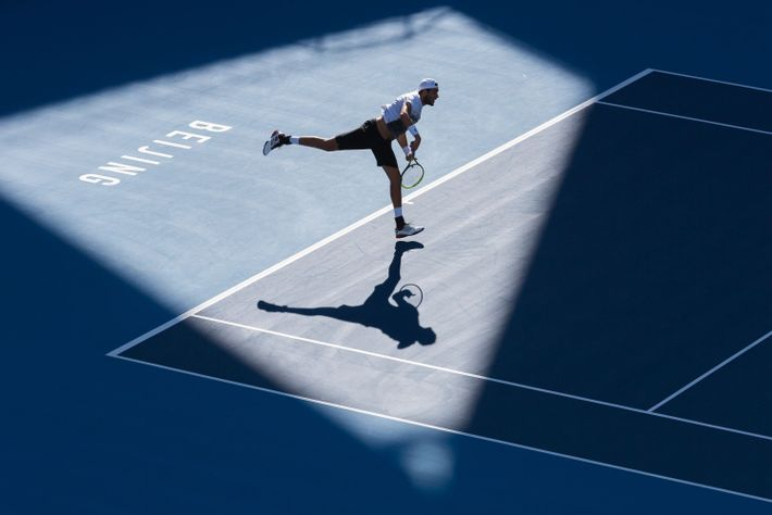Your Shot photographer Ian Webb captured a tennis player serving the ball during the China Open.