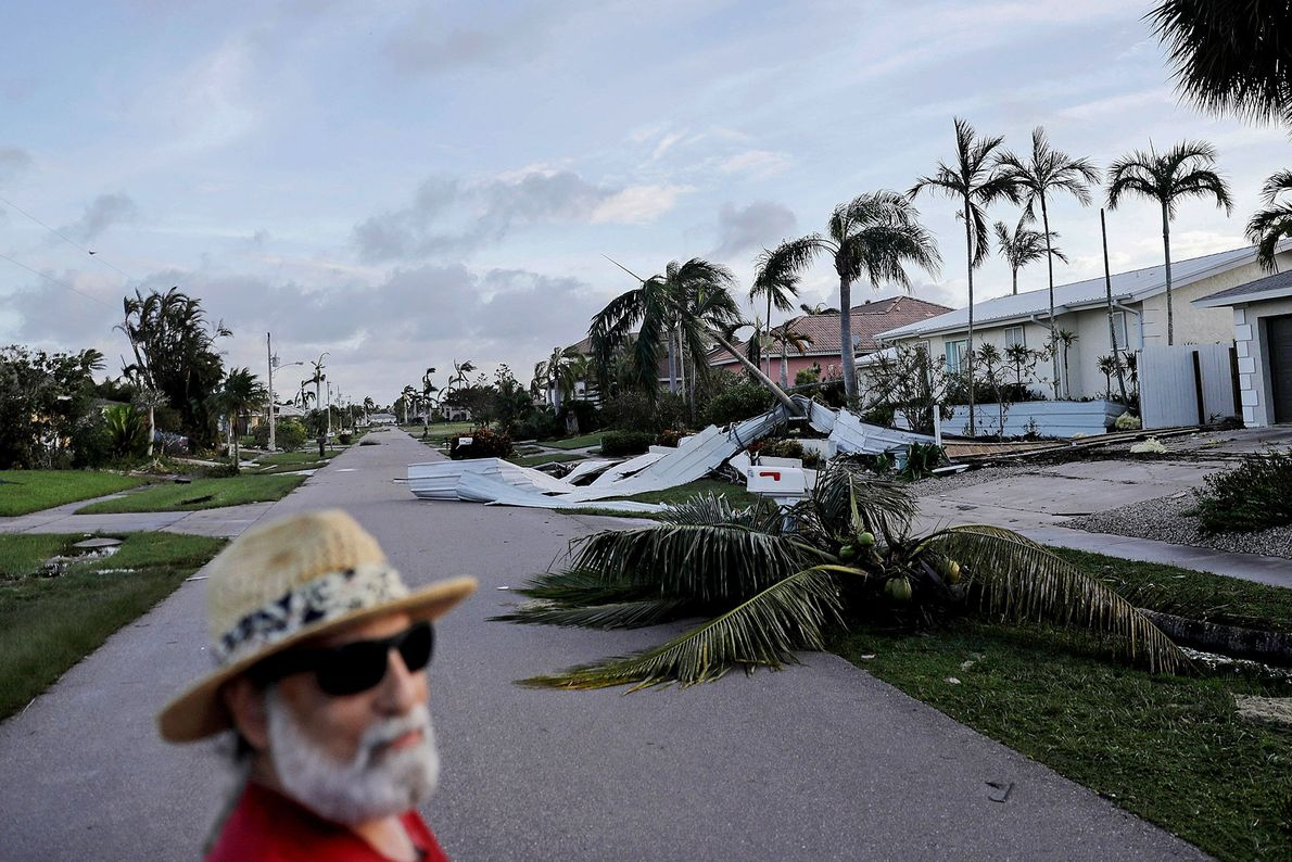 A resident of Marco Island, Florida checks the damage from Hurricane Irma in his neighbourhood on ...