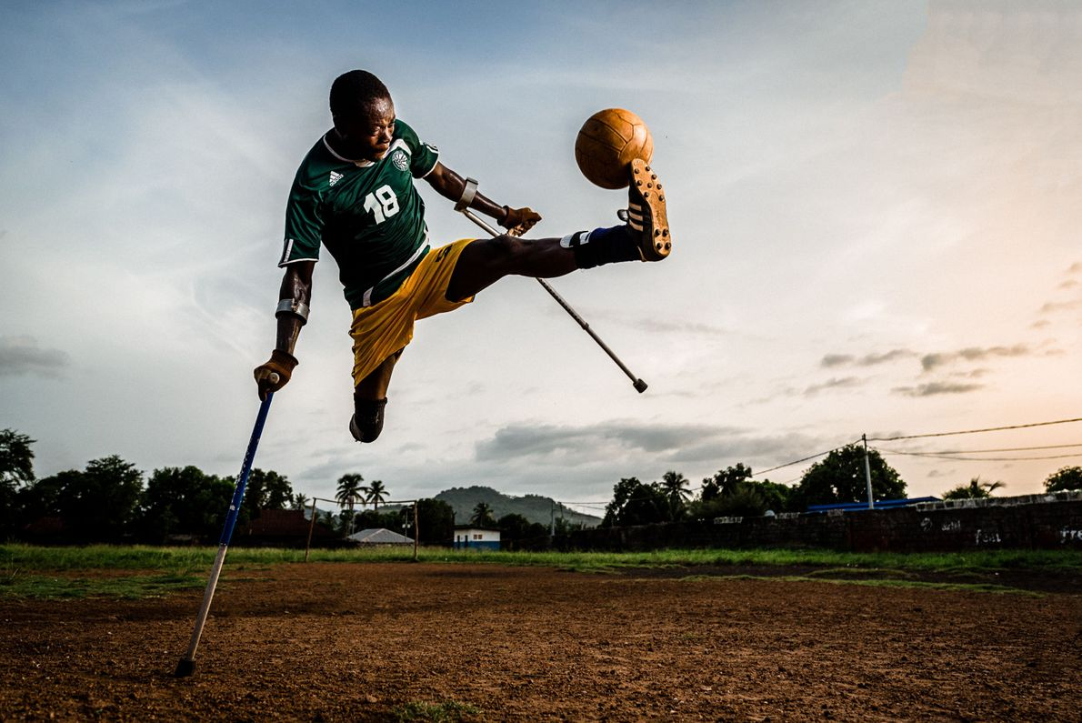 In Sierra Leone, Bombali Amputee Football Association team captain Mohamad intercepts the ball mid-flight, showing off ...