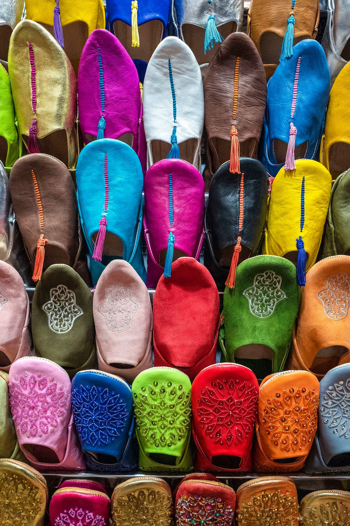 A colourful display of expertly crafted Moroccan slippers for sale in the famous slipper souk of ...