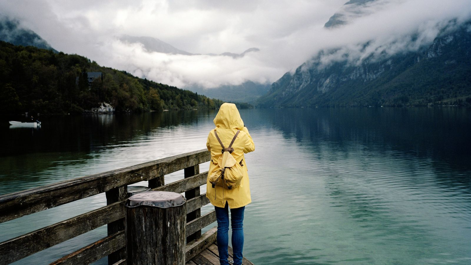 A tourist from Estonia takes a shot of Lake Bohinj in the morning mist. Whatever the ...