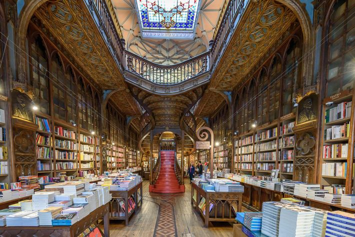 Harry Potter fans form queues along Porto's high street to glimpse inside Livraria Lello, which is erroneously ...