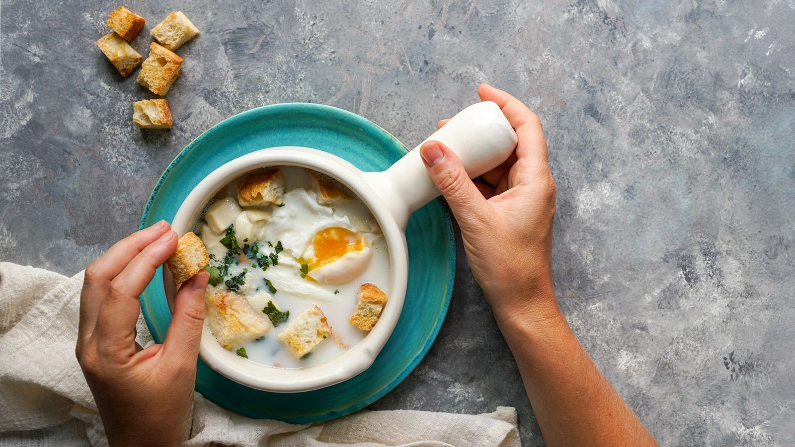 In Colombia, eggs are poached in milk and topped with coriander and f stale bread toform ...