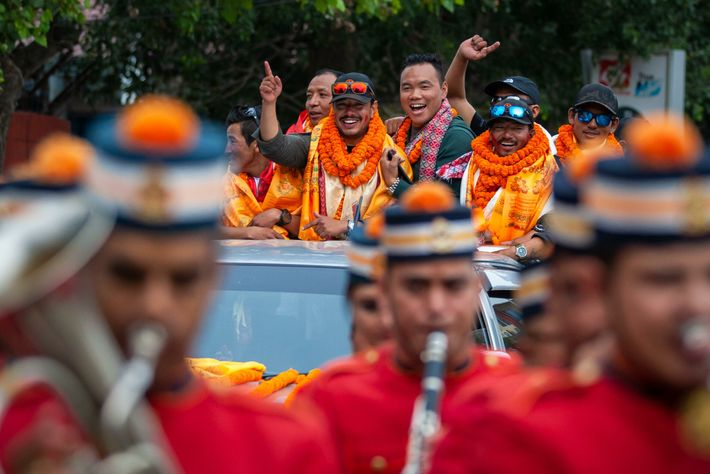 Nims Purja (centre, hand raised) arrives back to Kathmandu, October 2019, after completing all 14 8,000m ...