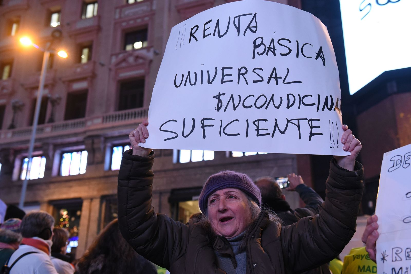 "Demonstrators gather in Madrid's Callao Square on International Human Rights Day, December 2019. The placard reads ""Universal ..."