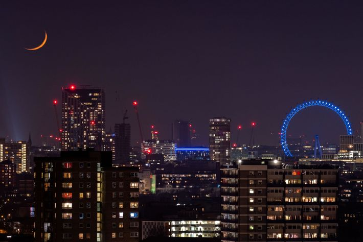 Landmarks of London, such as the London Eye, right, were lit emergency blue to honour the sacrifice ...