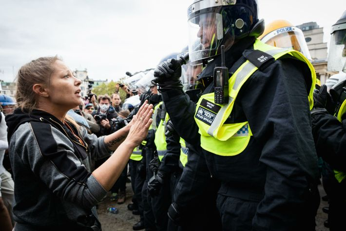 A protestor talks to a police officer as they move in on the Unite for Freedom ...