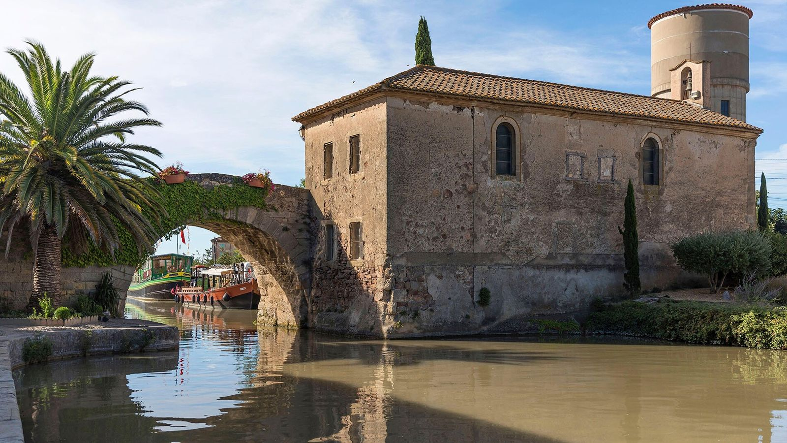 Stretching 150 miles from the Garonne River to the Mediterranean Sea, France's Canal du Midi is a ...
