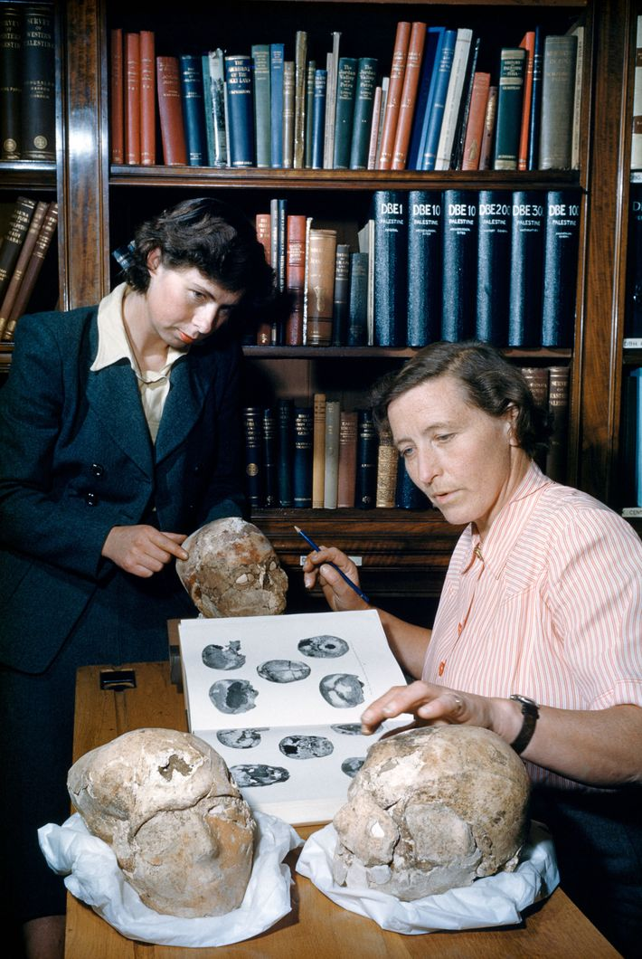 In this 1953 National Geographic photo, archaeologist Kathleen Kenyon (right) and technician Cecil Western examine Neolithic ...