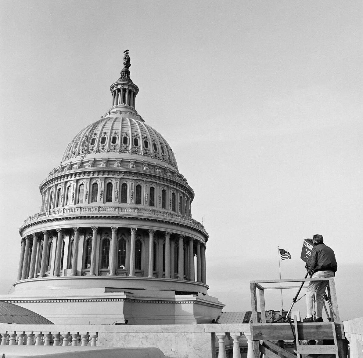 A cameraman in front of the dome of the U.S. Capitol Building during the inauguration of ...