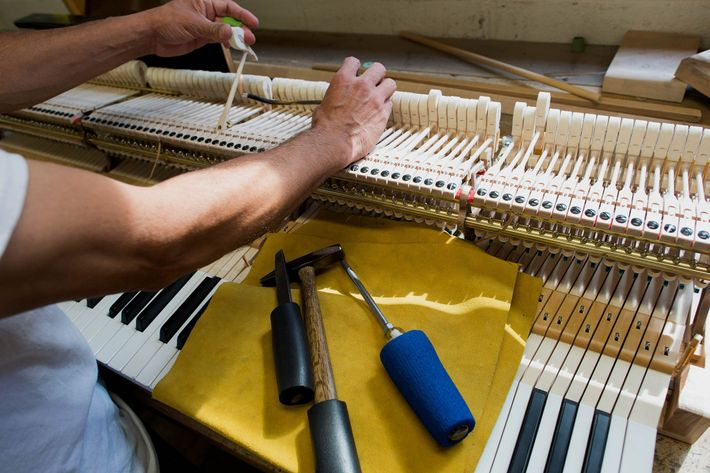 Visitors to the Steinway & Sons factory might be able to watch an employee work on ...