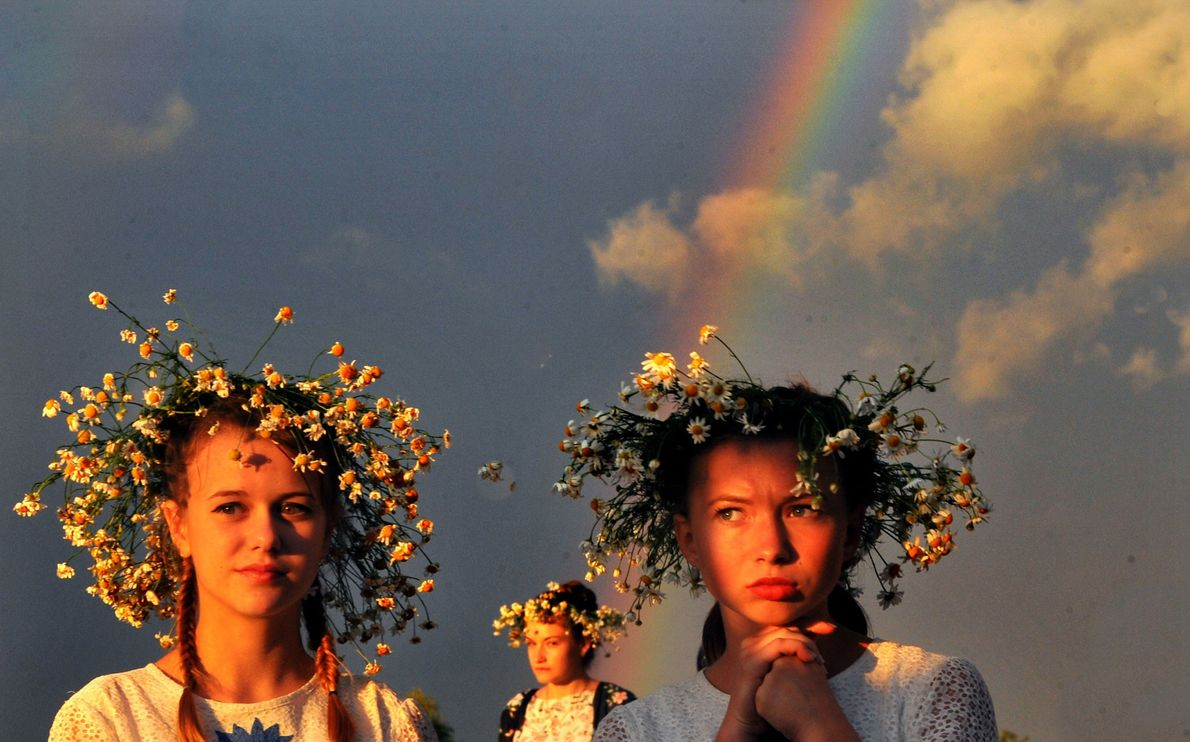 People wearing flower wreaths during festivities marking Ivan Kupala Day, a pagan summer solstice celebration, in ...